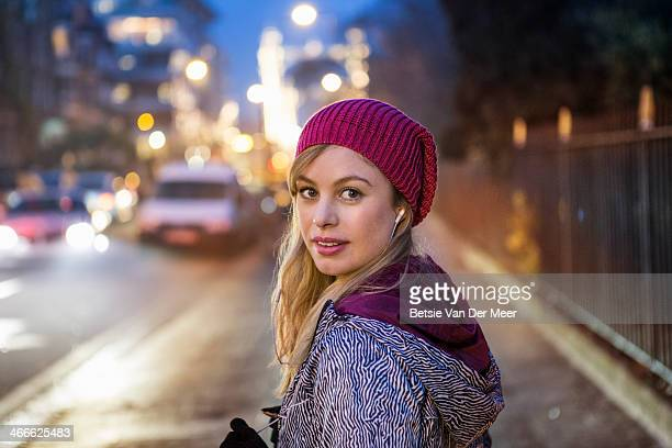 Portrait of female runner in city at night time.