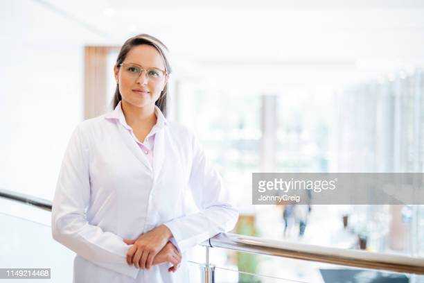 portrait of female scientist - junior doctor stock pictures, royalty-free photos & images
