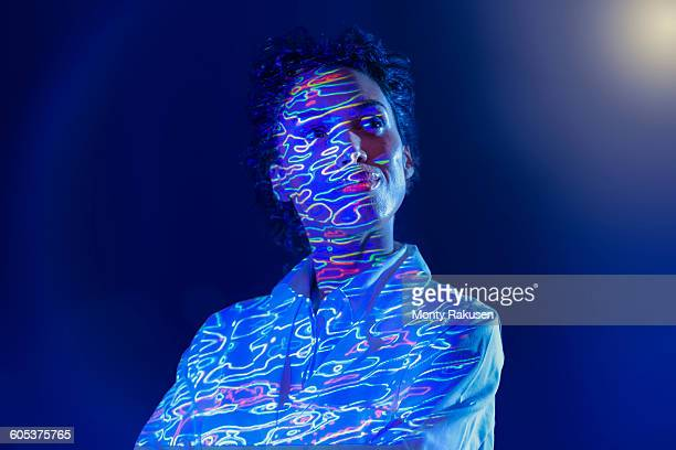 portrait of female scientist with graphical geological data projection - geologie stock-fotos und bilder