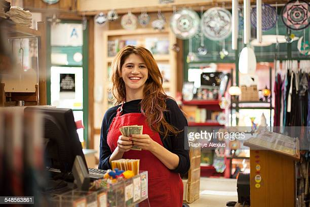 Portrait of female shop assistant in health food store