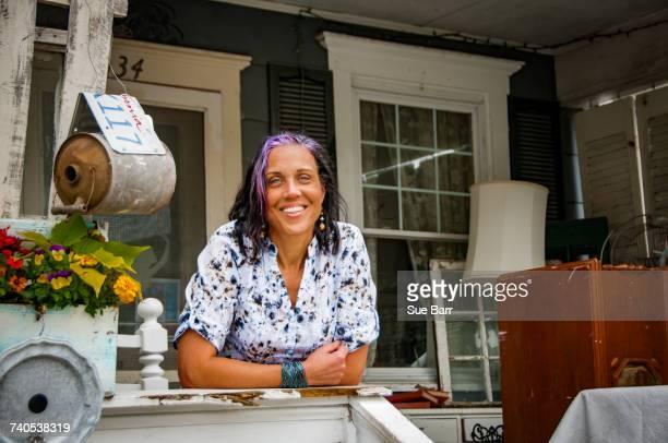 portrait of female shop keeper in front porch shabby chic shop - purple hair stock pictures, royalty-free photos & images