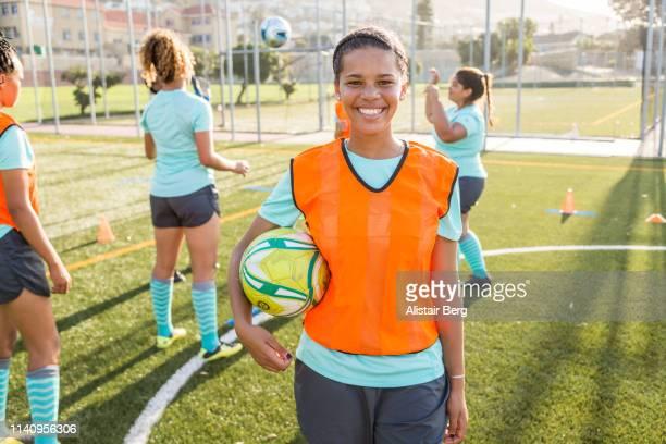 portrait of female soccer player at soccer team practice - voetbalteam stockfoto's en -beelden