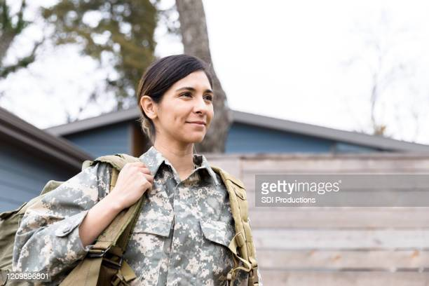 portrait of female soldier carrying gear - military stock pictures, royalty-free photos & images