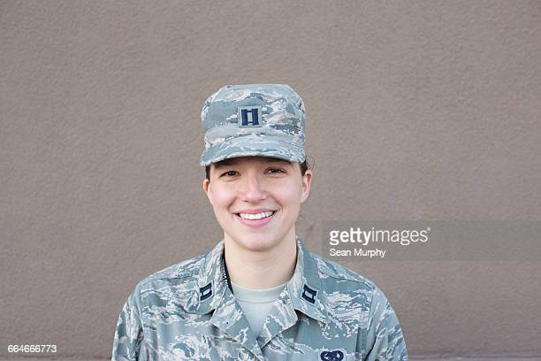 Portrait of female soldier in front of wall at air force military base