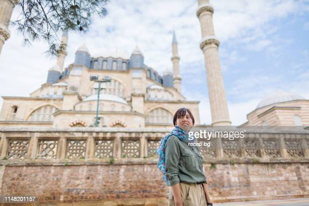 portrait of female solo traveler in front of mosque - selimiye mosque stock pictures, royalty-free photos & images