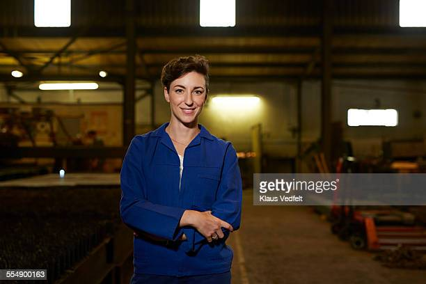 portrait of female steel worker - coveralls stock pictures, royalty-free photos & images