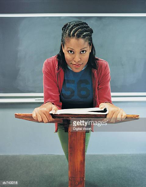 Portrait of Female Student Standing in front of Blackboard