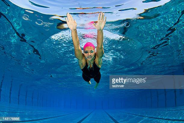 portrait of female swimmer at butterfly stroke - length stock pictures, royalty-free photos & images