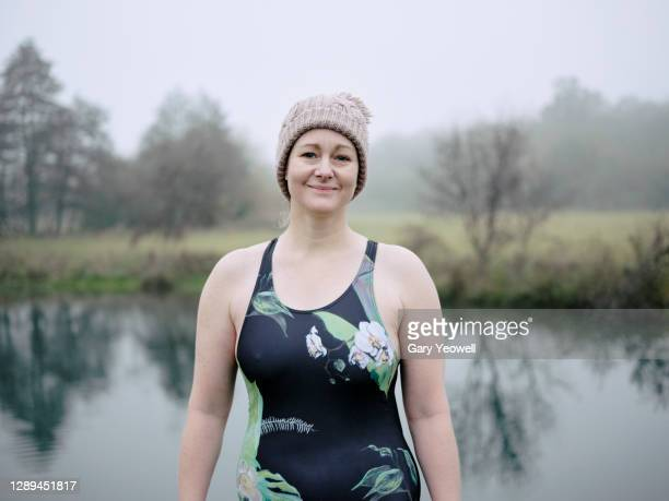 portrait of female swimmer in winter - swimming stock pictures, royalty-free photos & images