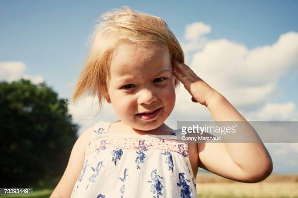portrait of female toddler in field with hand in blond hair - thuringia stock pictures, royalty-free photos & images