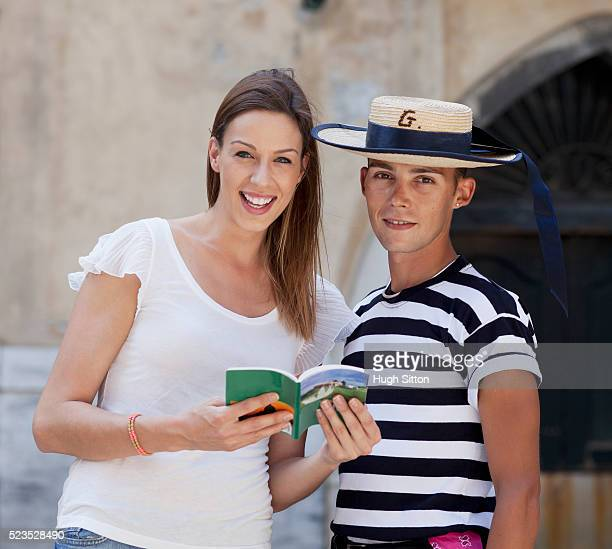portrait of female tourist and gondola driver - hugh sitton stock pictures, royalty-free photos & images