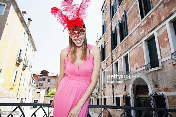 portrait of female tourist wearing venetian mask, venice, italy - hugh sitton stock pictures, royalty-free photos & images