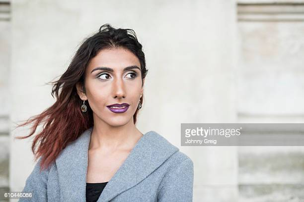 Portrait of female transgender with brown hair looking away