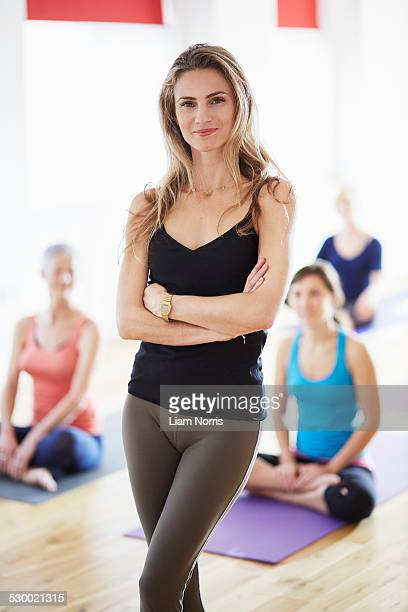 Portrait of female tutor in pilates class