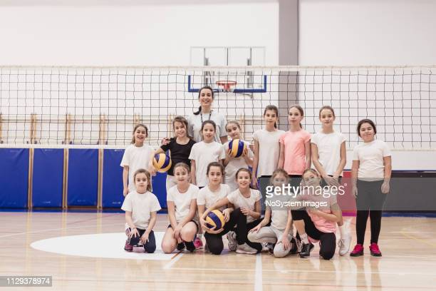 Portrait of female volleyball team on the court