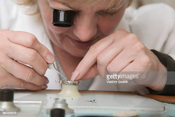 portrait of female watchmaker at work