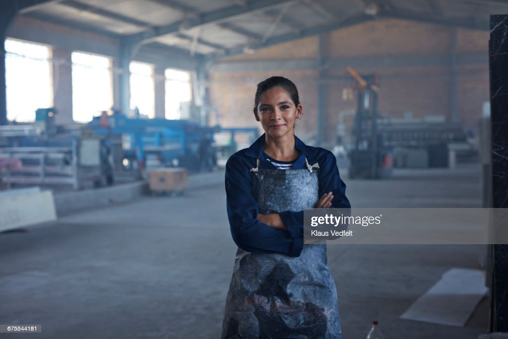 Portrait of female worker at factory : Stock Photo