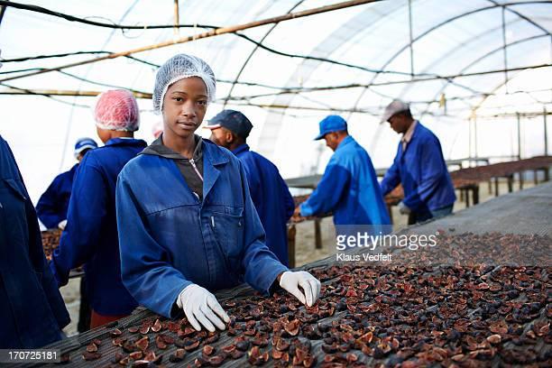 Portrait of female worker at fruit farm