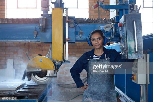 portrait of female worker at stone factory - toughness stock pictures, royalty-free photos & images