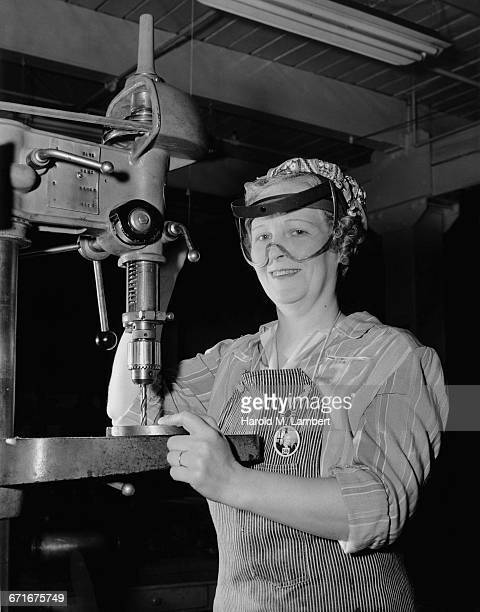 portrait of female worker working in factory - number of people stock pictures, royalty-free photos & images