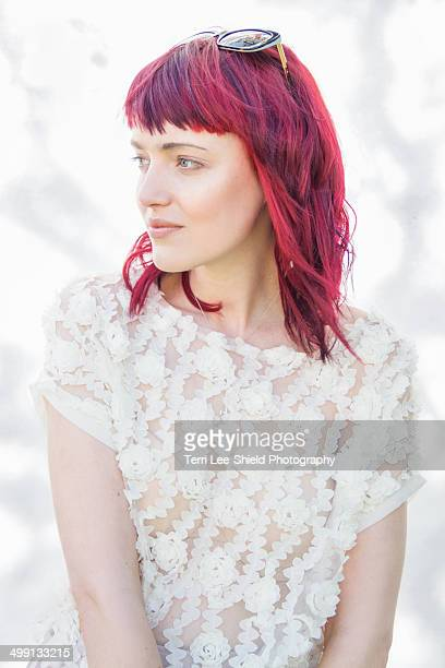 Portrait of feminine young woman with pink hair