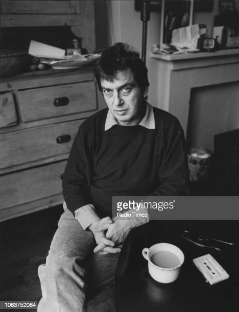 Portrait of film director Stephen Frears sitting at a table with a cup of tea, January 1986.