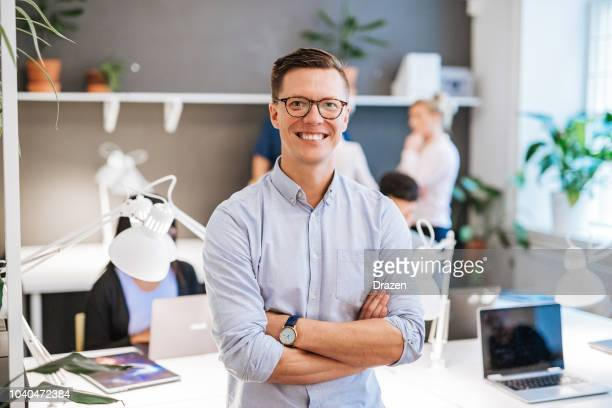 portrait of finish or scandinavian businessman with colleagues in office - nordic countries stock pictures, royalty-free photos & images