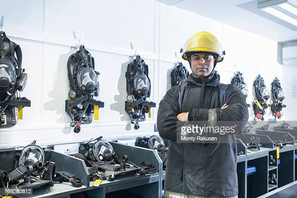 Portrait of firefighter in respirator storage room of fire simulation training facility