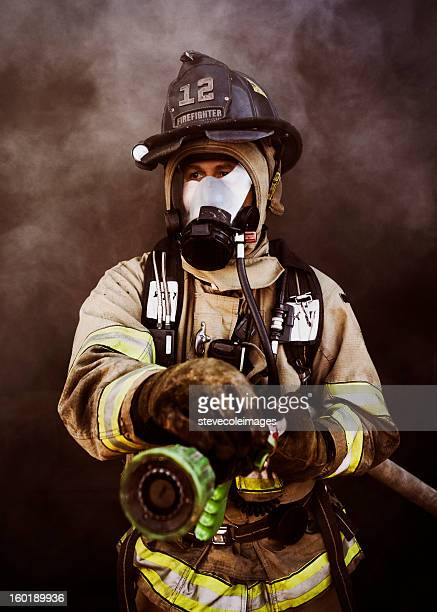 portrait of firefighter - fire protection suit stock pictures, royalty-free photos & images