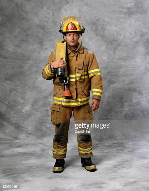 portrait of firefighter - fire protection suit - fotografias e filmes do acervo