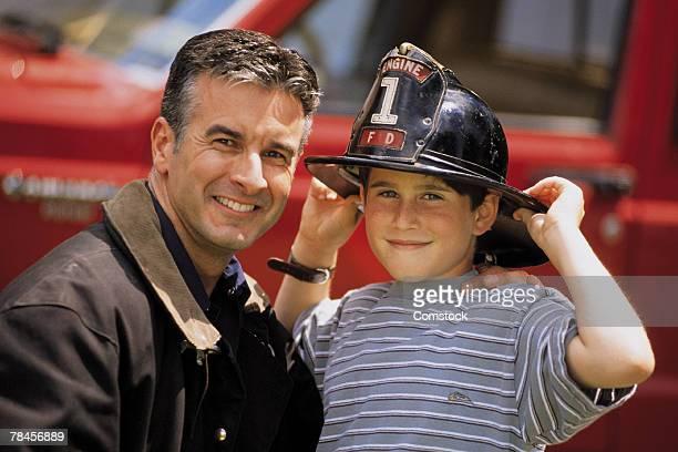 portrait of fireman with son - 1990~1999年 ストックフォトと画像
