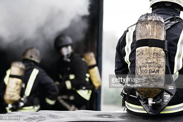 Portrait of firemen from Wiltshire Fire And Rescue Service photographed during a training exercise at Cotswold Airport in Gloucestershire taken on...