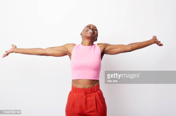 portrait of fit mature woman with arms outstretched - human limb stock pictures, royalty-free photos & images