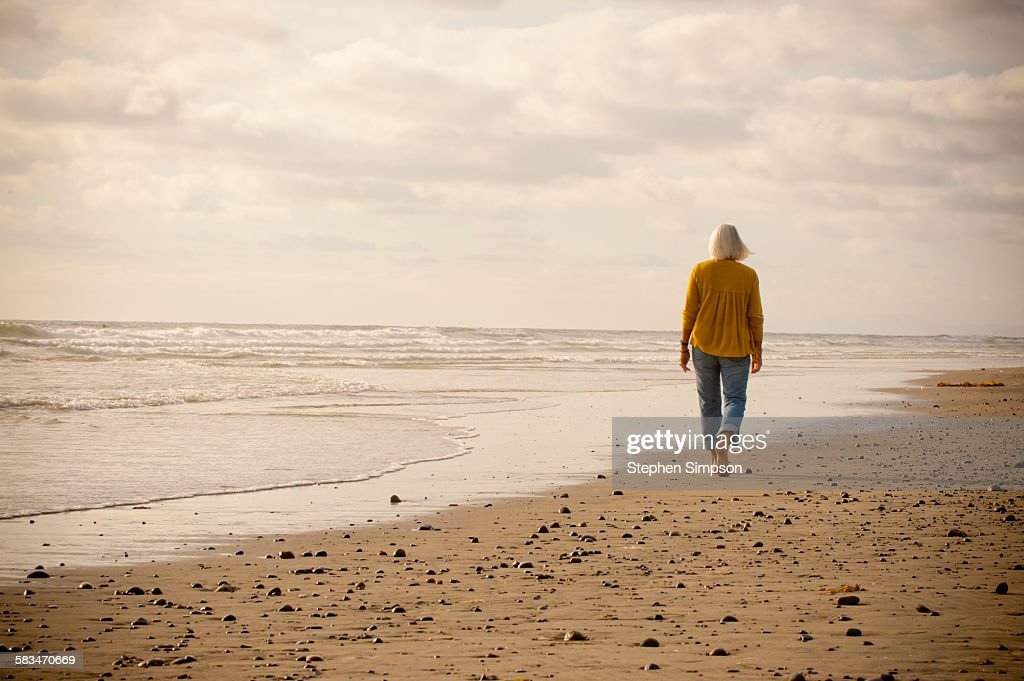 """portrait of fit """"senior"""" woman at the beach : Stock Photo"""