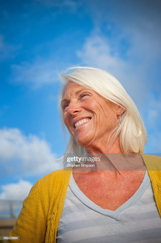 "portrait of fit ""senior"" woman at the beach : Stock Photo"