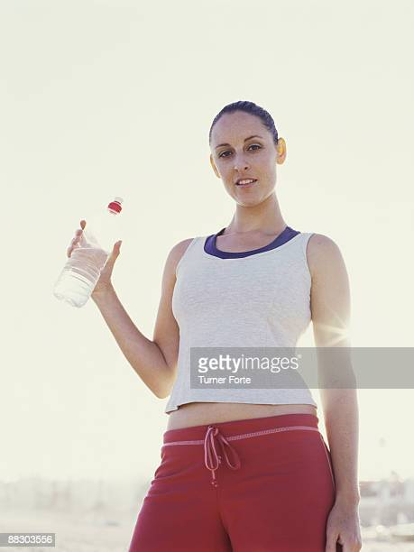 Portrait of fit woman with bottled water