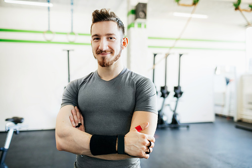 Portrait Of Fitness Trainer At Gym - gettyimageskorea