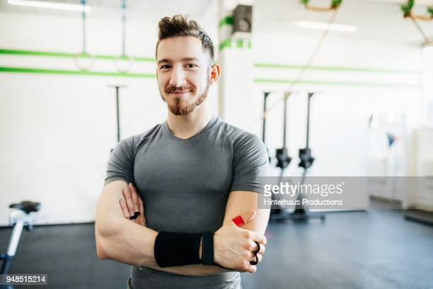 Portrait Of Fitness Trainer At Gym