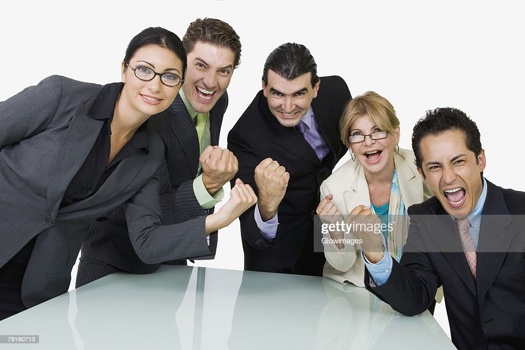 Portrait of five business executives cheering : Foto de stock