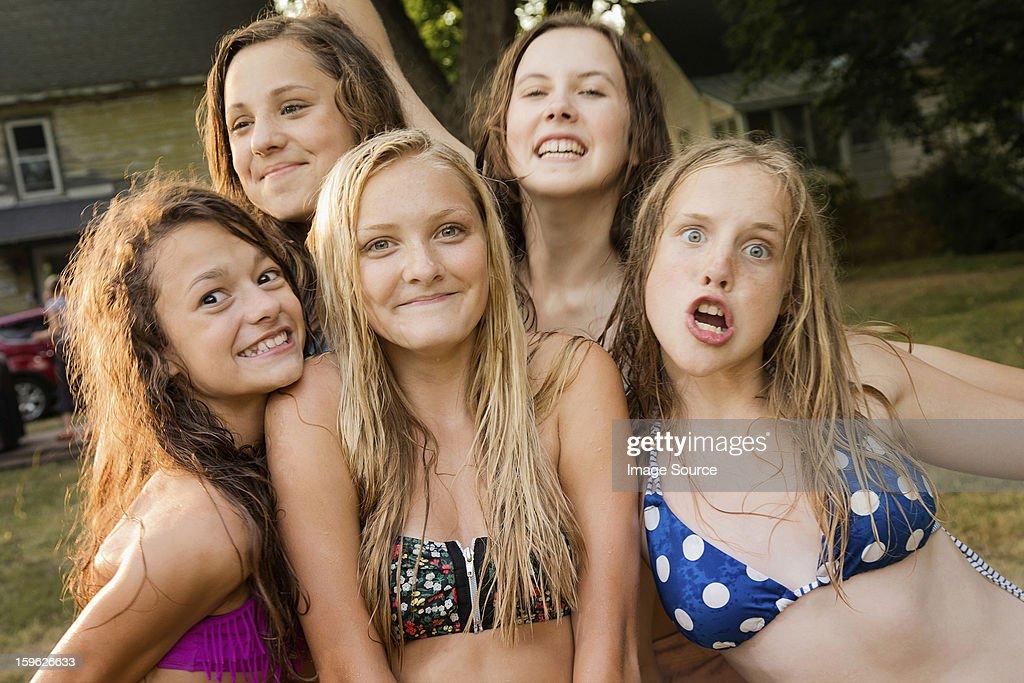 portrait of five girls wearing bikini tops stock photo
