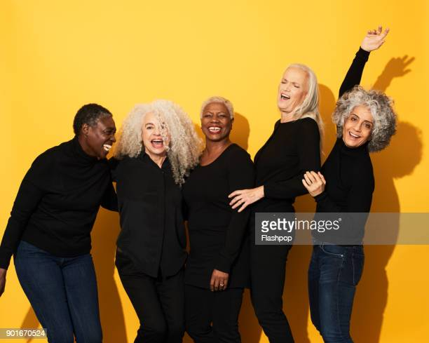 Portrait of five women laughing and having fun