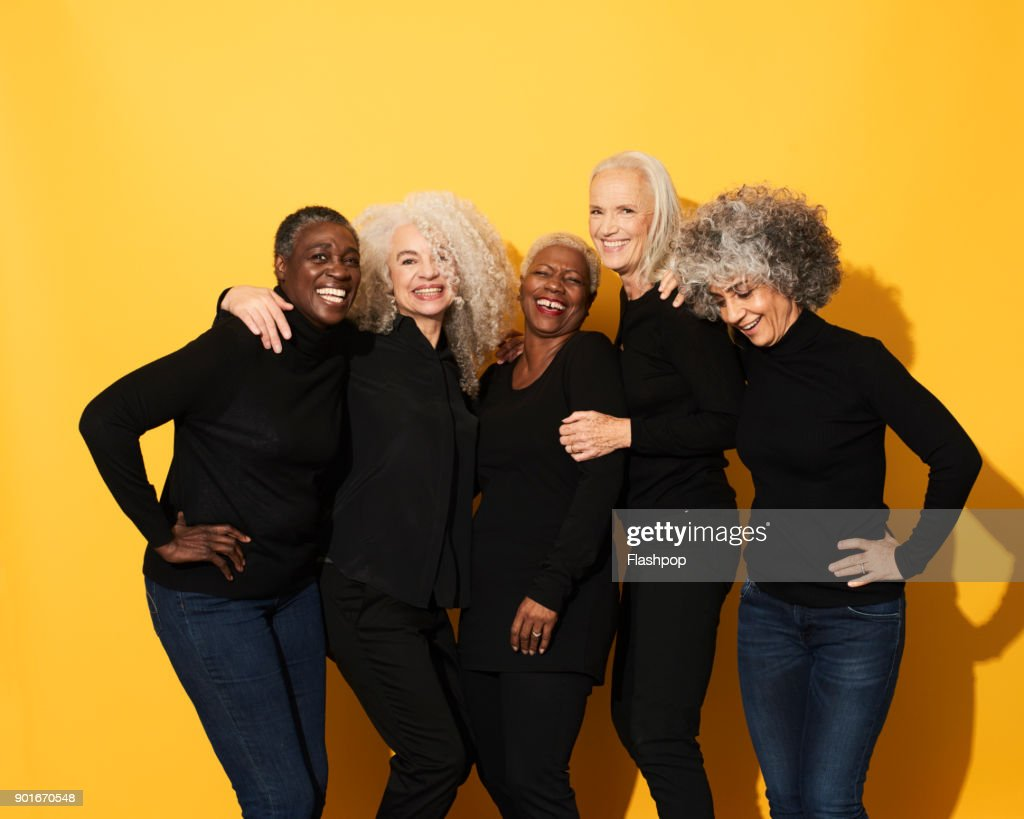 Portrait of five women laughing and having fun : Stock Photo