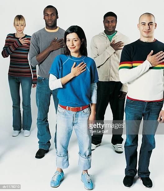 portrait of five young adults swearing the pledge of allegiance - geschworener stock-fotos und bilder