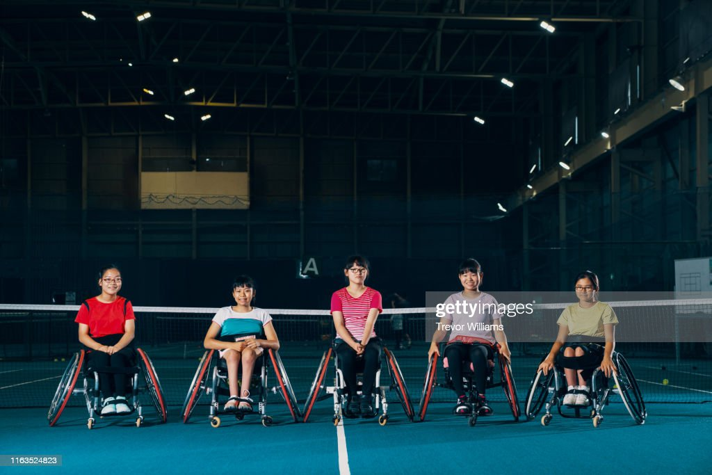 Portrait of five young female wheelchair tennis athletes : ストックフォト