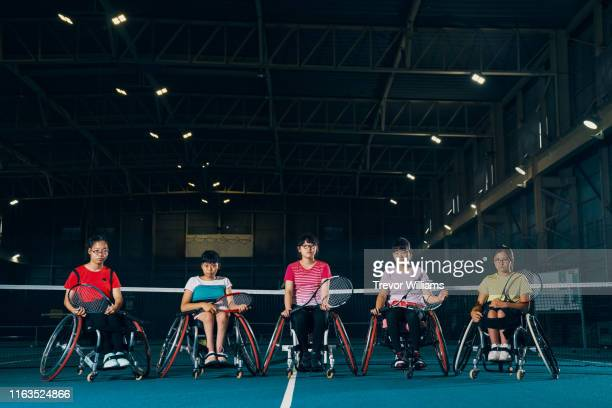 portrait of five young female wheelchair tennis athletes - 車いすテニス ストックフォトと画像