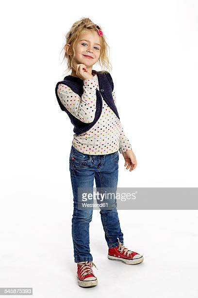 portrait of flirtatious blond little girl standing in front of white background - 4 5 anni foto e immagini stock