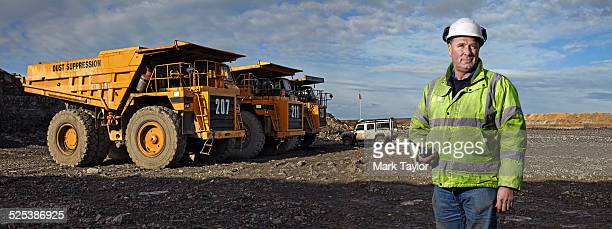 portrait of foreman with walkie talkie working at quarry - dump truck stock pictures, royalty-free photos & images
