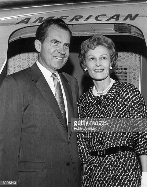 Portrait of former American Vice President Richard Nixon and his wife Pat smiling together in the entrance of an American Airlines jet before their...
