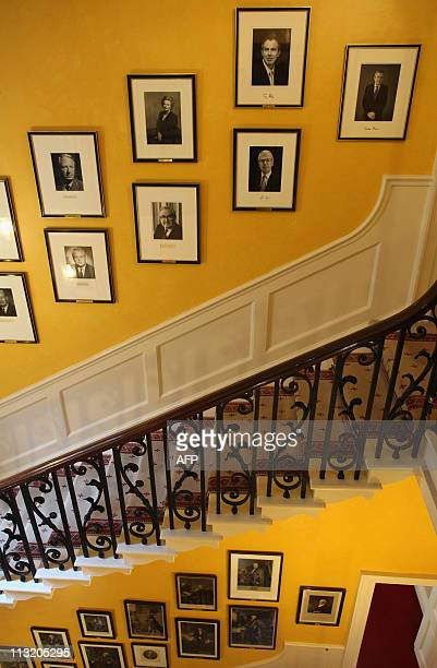 Portrait of former British Prime Minister Gordon Brown hangs at the top of the staircase at 10 Downing Street in central London, on April 27, 2011....