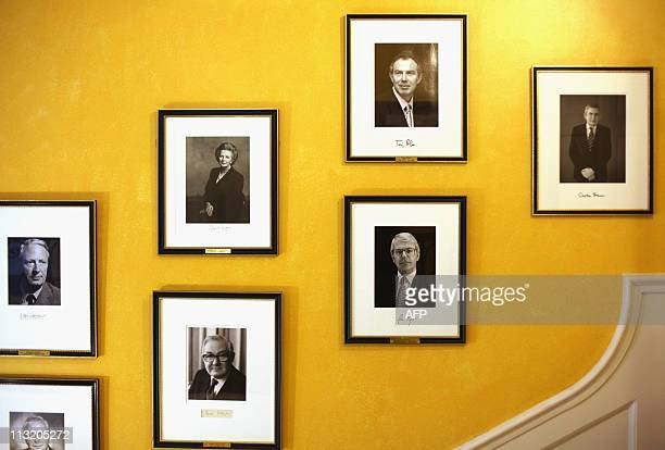 Portrait of former British Prime Minister Gordon Brown hangs on the staircase at 10 Downing Street in central London, on April 27, 2011. The portrait...